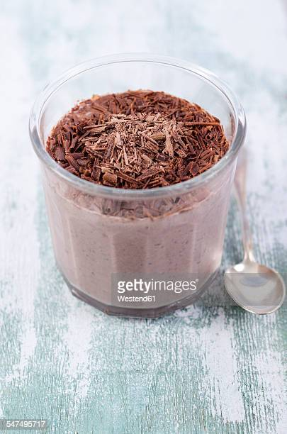 Glass of chocolate pudding with chia seeds sprinkled with chocolate shaving
