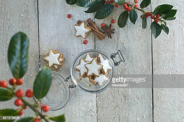 Glass of cinnamon stars and Christmas decoration