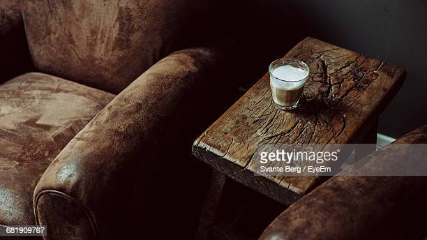 Glass Of Coffee On Rustic Wooden Coffee Table