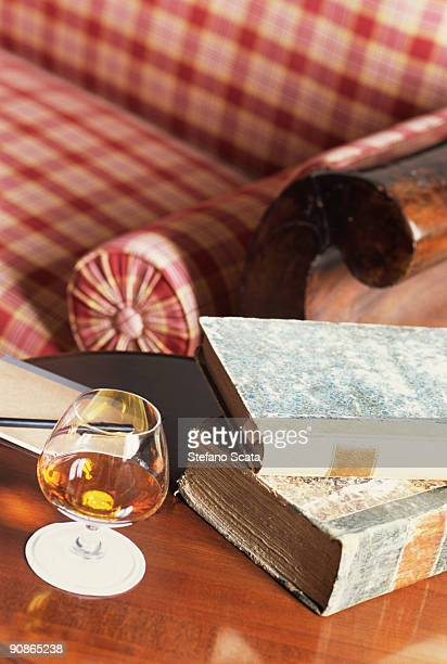 Glass of cognac and books