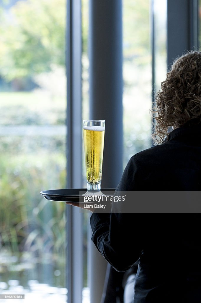 Glass of cool beer on a tray : Stock Photo