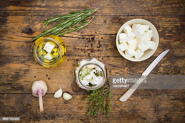 Glass of diced sheep cheese pickled in olive oil, thyme, garlic, pepper and rosmary