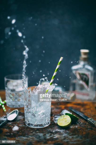 glass of drink on table - mojito stock photos and pictures
