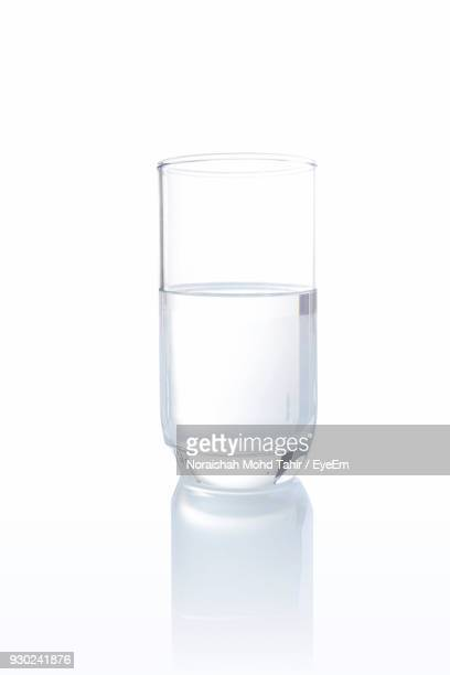 Glass Of Drinking Water Against White Background