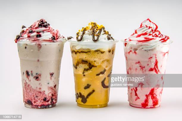 glass of frappe milkshake with milk and cherry fruit - milkshake stock pictures, royalty-free photos & images