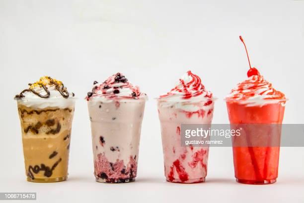 glass of frappe milkshake with milk and cherry fruit - azotes fotografías e imágenes de stock