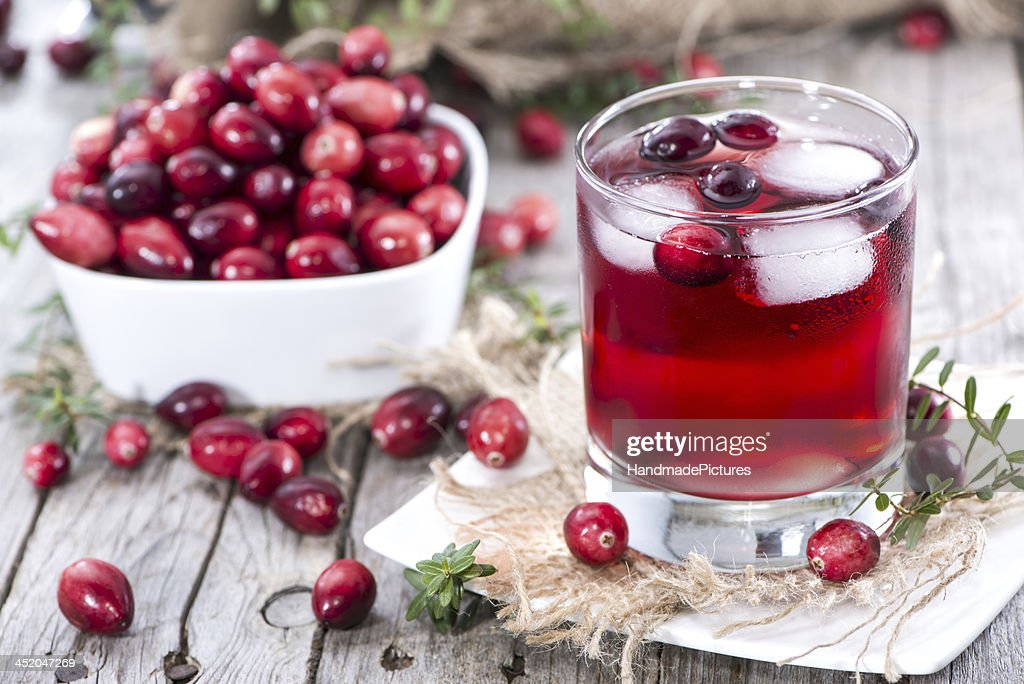 Glass of fresh cranberry juice and a bowl of cranberries : Stock Photo