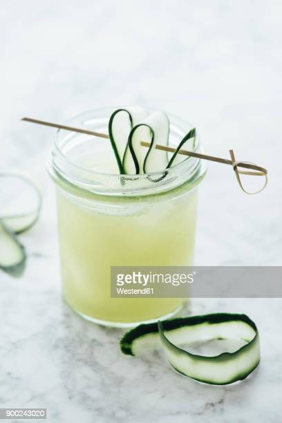 Glass of fresh cucumber juice with ice cubes