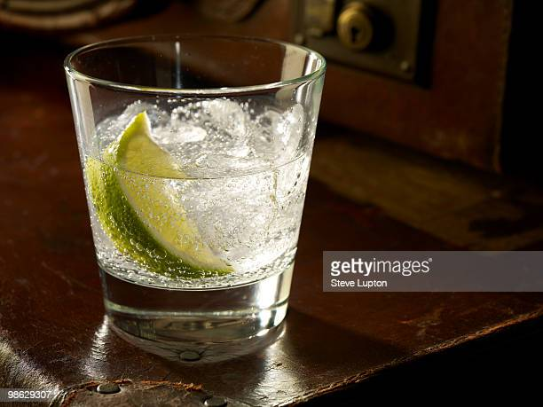 glass of gin and tonic with ice and lime - image stock pictures, royalty-free photos & images