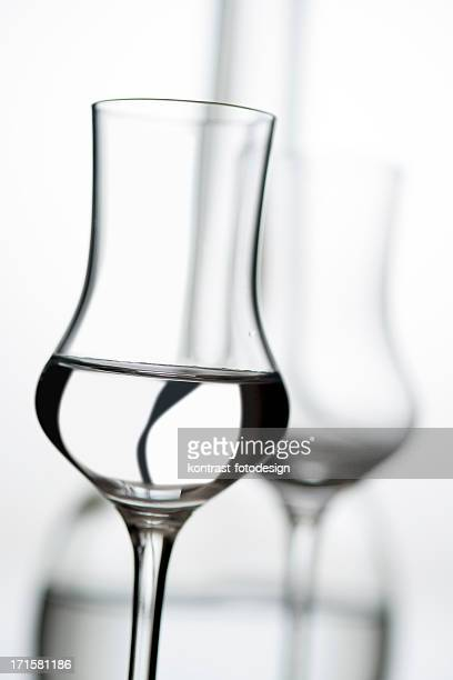 glass of grappa, fruit brandy - liqueur stock pictures, royalty-free photos & images