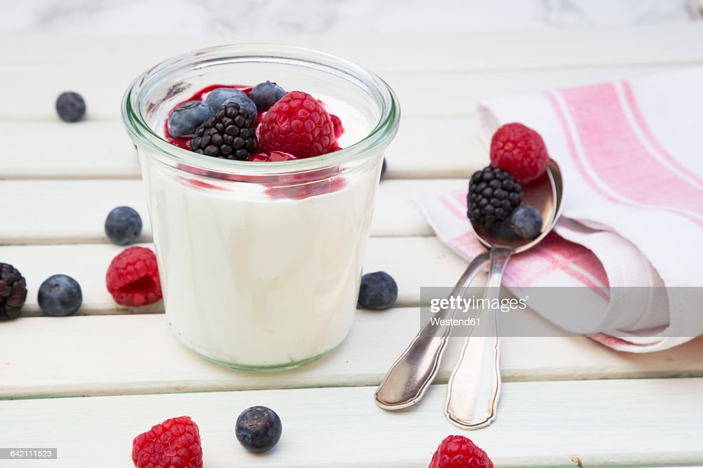 Glass of Greek yogurt with berries : Stock Photo