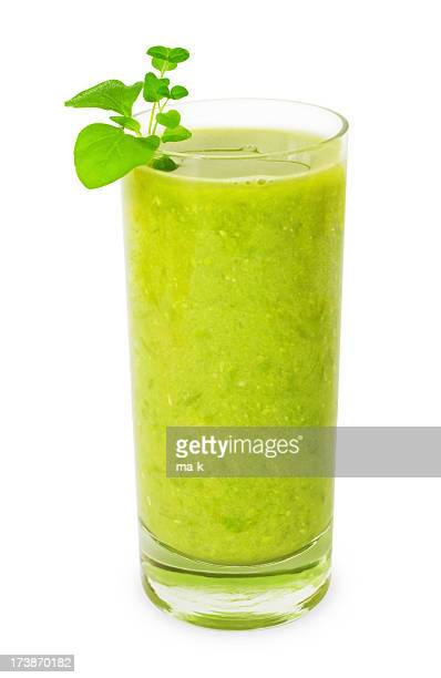 Glass of green smoothie isolated on white