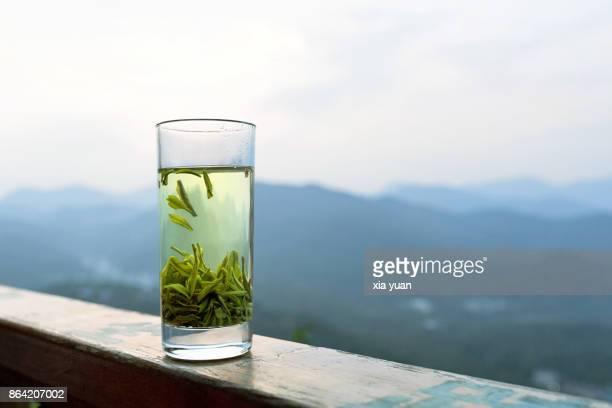 glass of green tea,hangzhou,china - color tipo de imagen fotografías e imágenes de stock