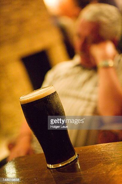 glass of guinness at the anglers rest pub. - guinness stock pictures, royalty-free photos & images