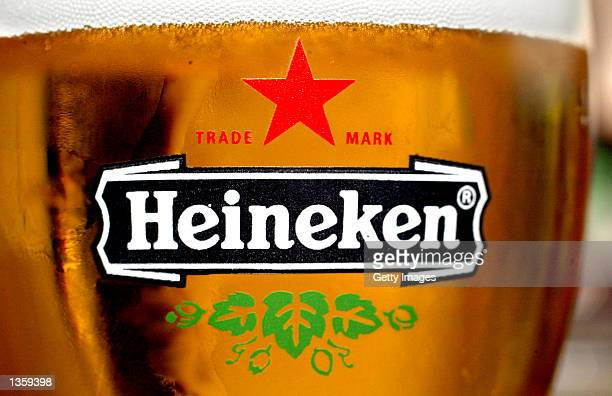 A glass of Heineken beer with the brand's logo is seen in a bar August 29 2002 in Amsterdam Netherlands The European Commission is investigating an...