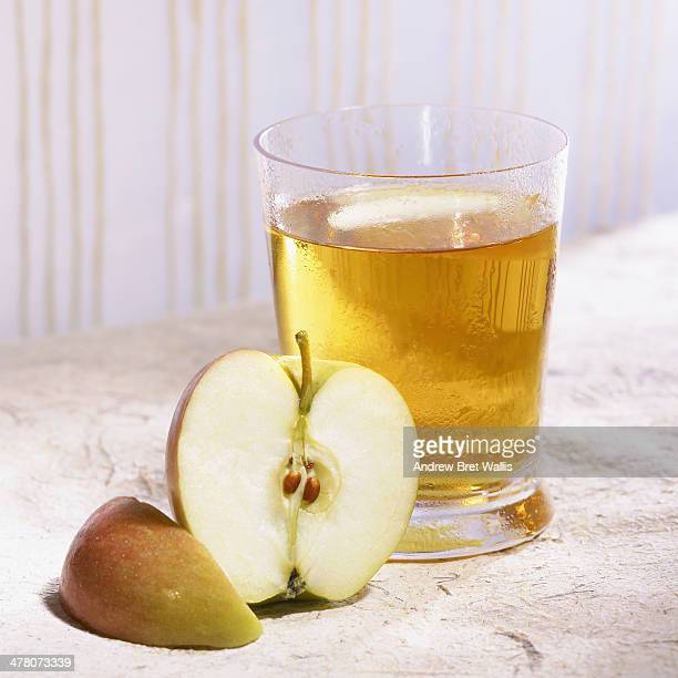 Glass of homemade apple juice with apple slices