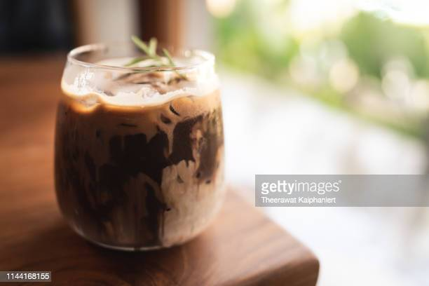 a glass of ice chocolate on the table (isolated background) - whipped food stock pictures, royalty-free photos & images