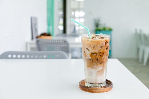 A glass of Ice coffee on the white table in coffee shop. - gettyimageskorea
