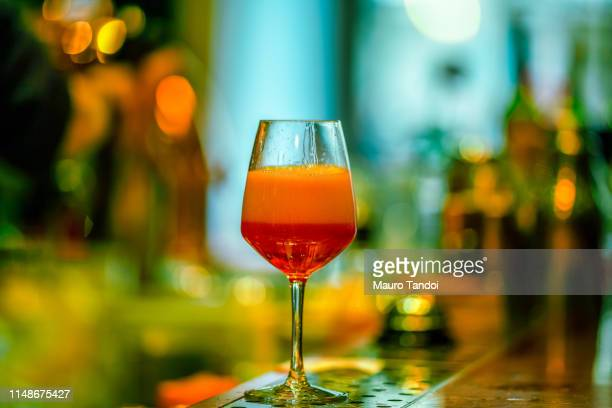glass of ice-cooled spritz with orange - mauro tandoi stock photos and pictures