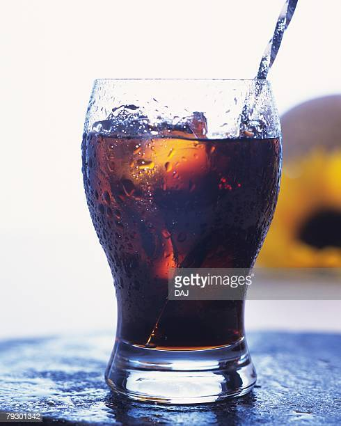 A glass of iced coffee, front view, white background, differential focus