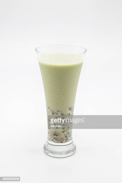 Glass of Iced Matcha Green Tea With Red Beans