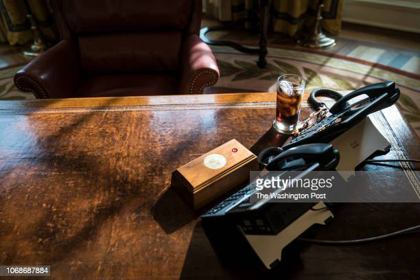 A glass of iced soda is seen on the Resolute Desk as President Donald Trump speaks during a meeting about the opportunity zones provided by tax...