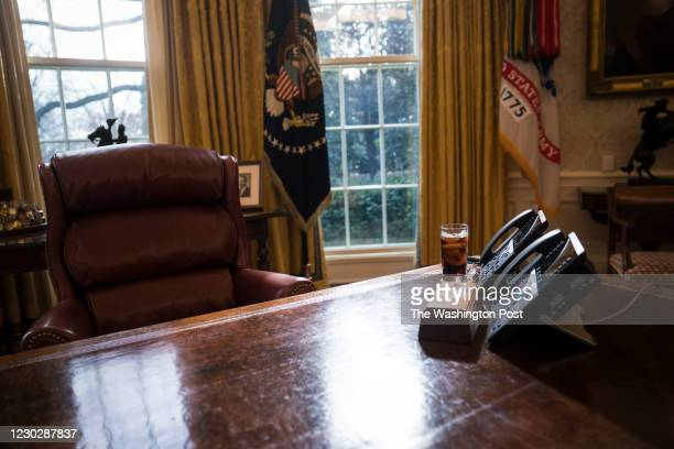 Glass of iced soda is seen on the Resolute Desk as President Donald Trump speaks during a meeting about the opportunity zones provided by tax reform...
