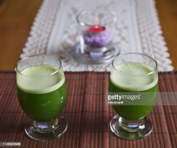 glass of japanese powdered green tea, matcha tea - chlorophyll stock pictures, royalty-free photos & images