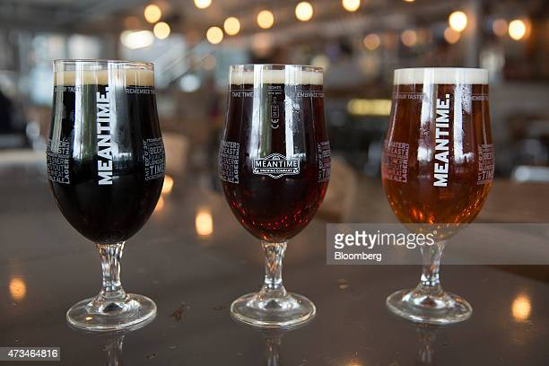A glass of London Stout from left Yakima Red and London Pale Ale are seen in this arranged photograph in the tasting rooms at the Meantime Brewing Co...