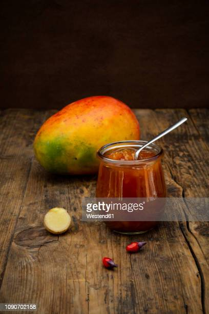 glass of mango chutney with ginger and chili - chutney stock pictures, royalty-free photos & images