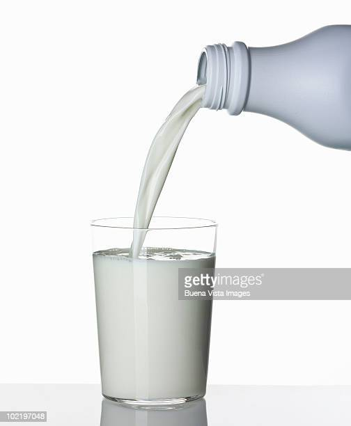 glass of milk - milk bottle stock pictures, royalty-free photos & images