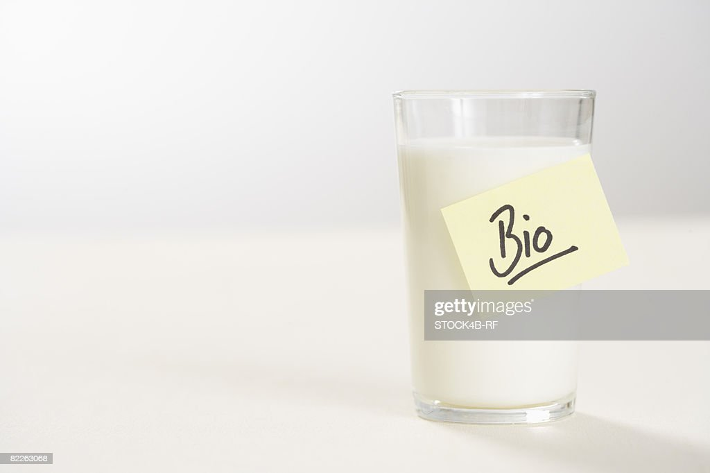 Glass of milk with a note on it : Stock Photo