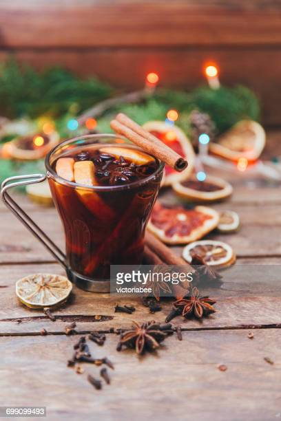 Glass of mulled wine and ingredients