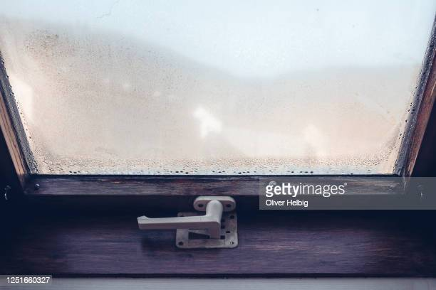 glass of old window with drops of condensed steam with drops of water. - humid stock pictures, royalty-free photos & images