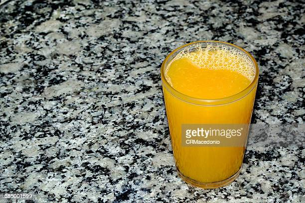 a glass of orange juice - crmacedonio stock photos and pictures