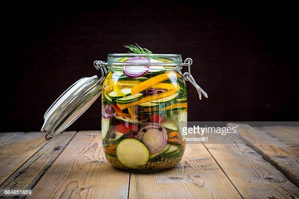 glass of pickled courgette and bell pepper - pickled stock pictures, royalty-free photos & images