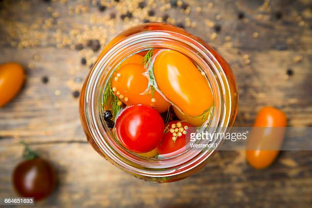 Glass of pickled tomatoes