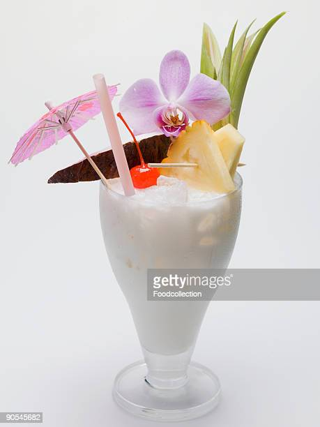 Glass of pina colada on white background, close up