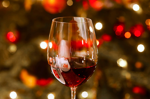 Glass of red wine at Christmas time, close-up - gettyimageskorea