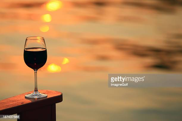 Glass of Red Wine by the Lake