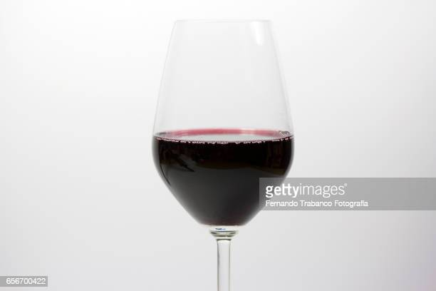 Glass of red wine in a bar