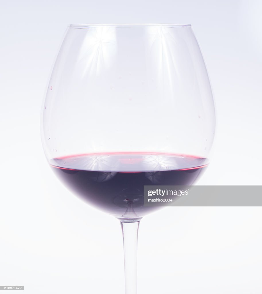 glass of red wine in the foreground : Stock Photo