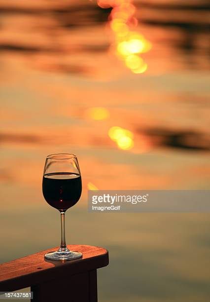 Glass of Red Wine on Rustic Beach Chair