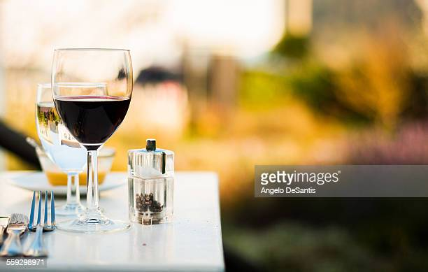 Glass of red wine on table