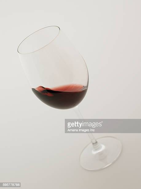 Glass of red wine, white background