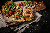 glass rose wine pizza with mushrooms