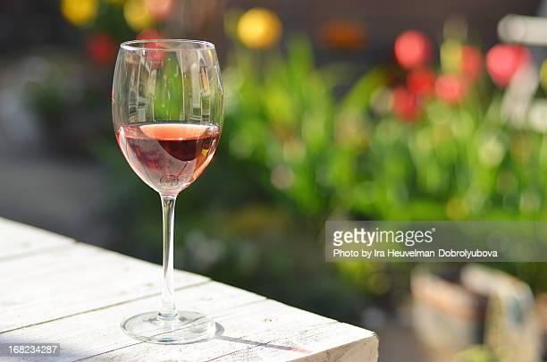 Glass of rose wine in summer garden