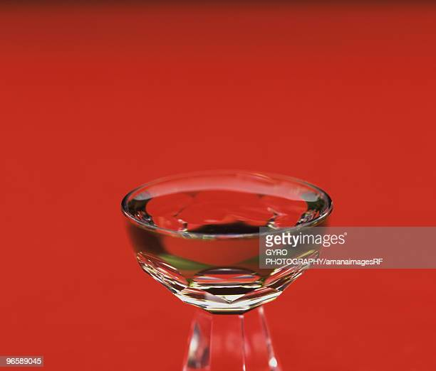 Glass of Sake, close up, red background