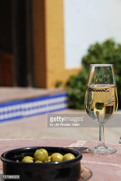 Glass of sherry wine with olives