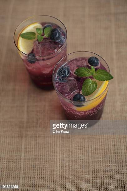 Glass of soda with blueberry and lemon